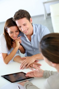 Young couple meeting financial adviser